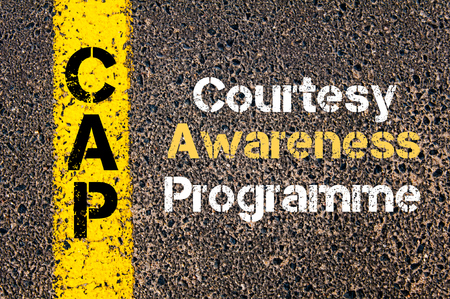 a courtesy: Concept image of Business Acronym CAP Courtesy Awareness Programme written over road marking yellow paint line Stock Photo