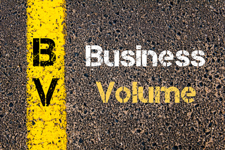 road marking: Concept image of Business Acronym BV Business Volume written over road marking yellow paint line