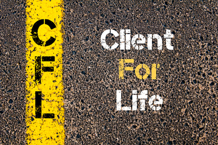 business life line: Concept image of Business Acronym CFL Client For Life written over road marking yellow paint line Stock Photo