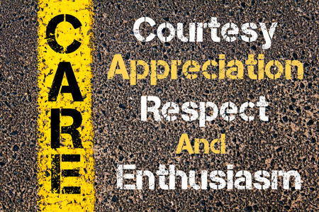 Concept image of Business Acronym CARE Courtesy Appreciation Respect And Enthusiasm written over road marking yellow paint line