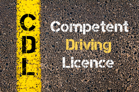competent: Concept image of Business Acronym CDL Competent Driving Licence written over road marking yellow paint line
