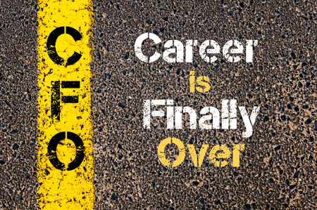 cfo: Concept image of Business Acronym CFO Career is Finally Over written over road marking yellow paint line