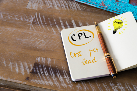 cpl: Retro effect and toned image of notebook next to a fountain pen. Business acronym CPL COST PER LEAD with handwritten text Stock Photo