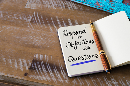 objections: Retro effect and toned image of notebook next to a fountain pen. Business concept image with handwritten text RESPOND TO OBJECTIONS WITH QUESTIONS , copy space available