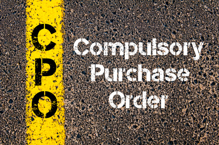 Concept image of Business Acronym CPO Compulsory Purchase Order written over road marking yellow paint line Stock Photo