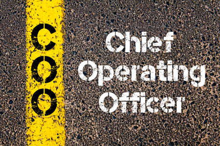 coo: Concept image of Business Acronym COO Chief Operating Officer written over road marking yellow paint line Stock Photo