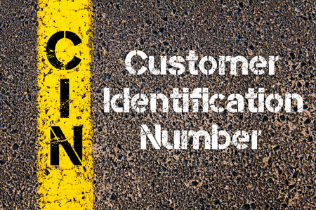 cin: Concept image of Business Acronym CIN Customer Identification Number written over road marking yellow paint line