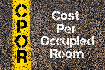 occupied: Concept image of Business Acronym CPOR Cost Per Occupied Room written over road marking yellow paint line