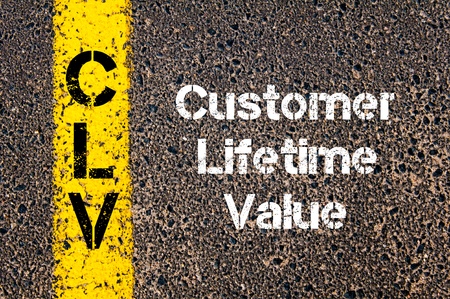 road marking: Concept image of Business Acronym CLV Customer Lifetime Value written over road marking yellow paint line Stock Photo