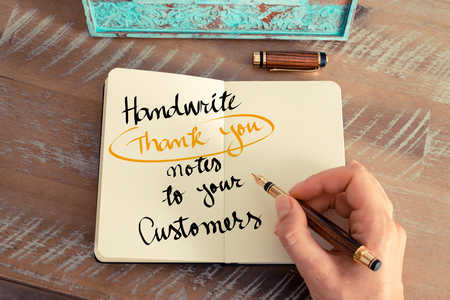handwrite: Retro effect and toned image of a woman hand writing a note with a fountain pen on a notebook. Handwritten text Handwrite Thank You Notes To Your Customers as business concept image