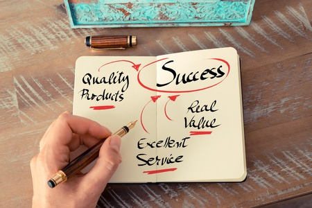 pen quality: Retro effect and toned image of a woman hand writing a note with a fountain pen on a notebook. Handwritten text Quality Products, Real Value, Excellent Service get Success as business concept image