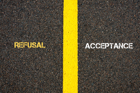refusal: Antonym concept of REFUSAL versus ACCEPTANCE written over tarmac, road marking yellow paint separating line between words