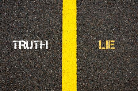 lie forward: Antonym concept of TRUTH versus LIE written over tarmac, road marking yellow paint separating line between words
