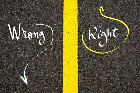 contradiction: Road marking yellow paint dividing line between Right and Wrong words going in different directions, Find Your Own Way concept