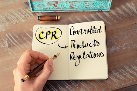 controlled: Retro effect and toned image of a woman hand writing a note with a fountain pen on a notebook. Business Acronym CPR as Controlled Products Regulations as business concept image