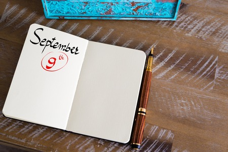 september 9th: Concept image of September 9 Calendar Day with empty space for text as handwritten note with fountain pen on a notebook