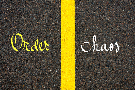 order chaos: Road marking yellow paint dividing line between Order and Chaos words going in different directions, Find Your Own Way concept