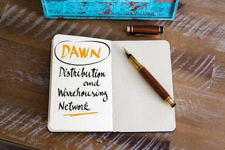 warehousing: Retro effect and toned image of a fountain pen on a notebook. Business Acronym DAWN as Distribution and Warehousing Network as business concept image