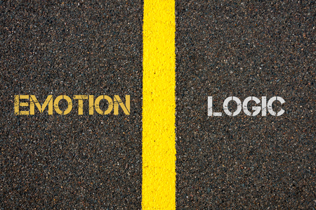 l�gica: Antonym concept of EMOTION versus LOGIC written over tarmac, road marking yellow paint separating line between words