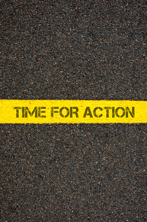 yellow line: Road marking yellow paint dividing line with words TIME FOR ACTION, concept image