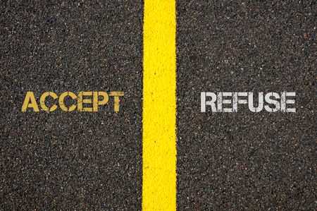 refuse: Antonym concept of ACCEPT versus REFUSE written over tarmac, road marking yellow paint separating line between words