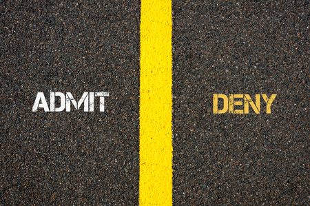 deny: Antonym concept of ADMIT versus DENY written over tarmac, road marking yellow paint separating line between words Stock Photo