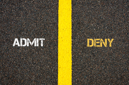 contradiction: Antonym concept of ADMIT versus DENY written over tarmac, road marking yellow paint separating line between words Stock Photo