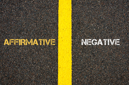affirmative: Antonym concept of AFFIRMATIVE versus NEGATIVE written over tarmac, road marking yellow paint separating line between words
