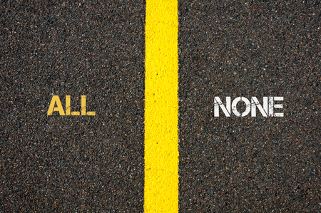 none: Antonym concept of ALL versus NONE written over tarmac, road marking yellow paint separating line between words