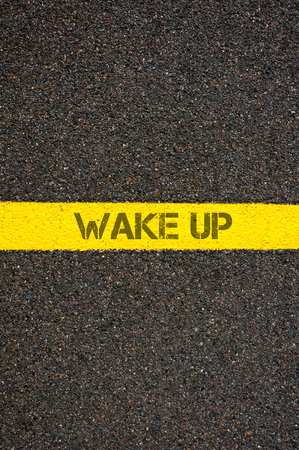 marking up: Road marking yellow paint dividing line with words WAKE UP, concept image Stock Photo