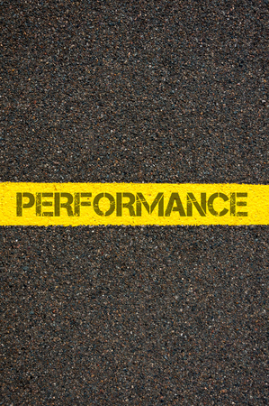 yellow line: Road marking yellow paint dividing line with word PERFORMANCE, concept image Stock Photo