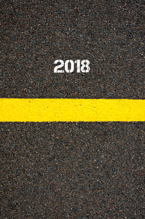 contradiction: Road marking yellow paint dividing line year 2018, concept image