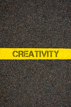 contradiction: Road marking yellow paint dividing line with word CREATIVITY, concept image Stock Photo
