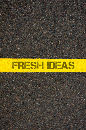 yellow line: Road marking yellow paint dividing line with words FRESH IDEAS, concept image Stock Photo
