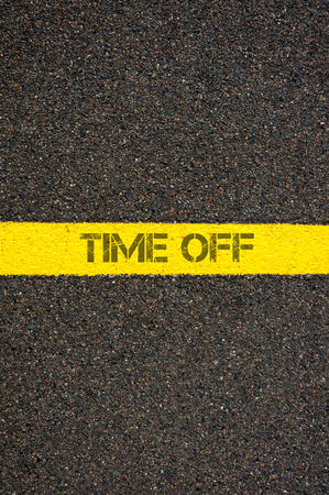 time off: Road marking yellow paint dividing line with words TIME OFF, concept image
