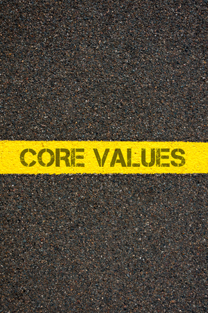 road marking: Road marking yellow paint dividing line with words CORE VALUES, concept image