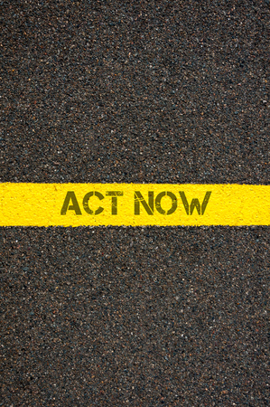 challenges ahead: Road marking yellow paint dividing line with words ACT NOW, concept image Stock Photo