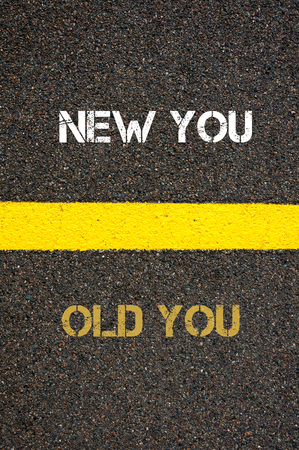 challenges ahead: Antonym decision concept of OLD YOU versus NEW YOU written over tarmac, road marking yellow paint separating line between words