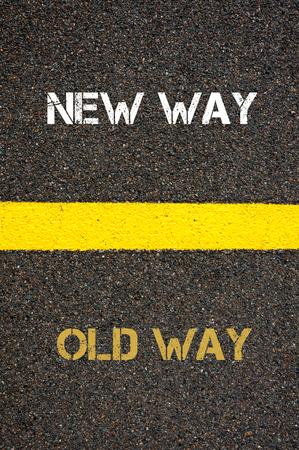 new way: Antonym decision concept of OLD WAY versus NEW WAY written over tarmac, road marking yellow paint separating line between words