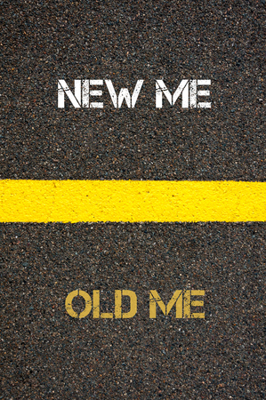 versus: Antonym decision concept of OLD ME versus NEW ME written over tarmac, road marking yellow paint separating line between words Stock Photo