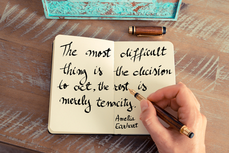 difficult decision: Retro effect and toned image of a woman hand writing on a notebook. Handwritten quote The most difficult thing is the decision to act, the rest is merely tenacity. - Amelia Earhart as concept image