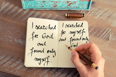 personal god: Retro effect and toned image of a woman hand writing on a notebook. Handwritten quote I searched for God and found only myself. I searched for myself and found only God as inspirational concept image