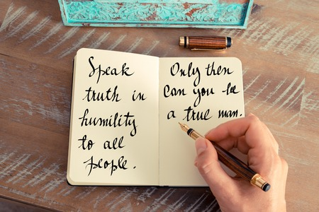 humility: Retro effect and toned image of a woman hand writing on a notebook. Handwritten quote Speak truth in humility to all people. Only then can you be a true man as inspirational concept image