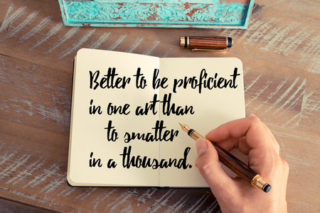 proficient: Retro effect and toned image of a woman hand writing on a notebook. Handwritten quote Better to be proficient in one art than to smatter in a thousand as inspirational concept image