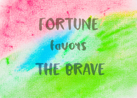 favors: Fortune favors the brave. Inspirational quote over abstract water color textured background Stock Photo