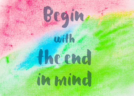 Begin with the end in mind. Inspirational quote over abstract water color textured background Stock Photo