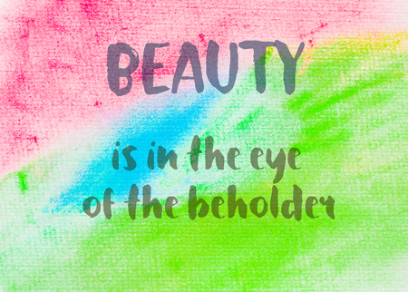 beholder: Beauty is in the eye of the beholder. Inspirational quote over abstract water color textured background