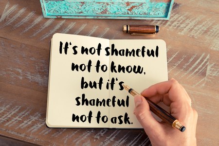 but think: Retro effect and toned image of a woman hand writing on a notebook. Handwritten quote Its not shameful not to know, but its shameful not to ask as inspirational concept image