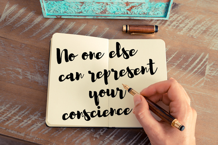 conscience: Retro effect and toned image of a woman hand writing on a notebook. Handwritten quote No one else can represent your conscience as inspirational concept image