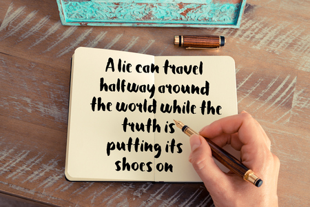 lie forward: Retro effect and toned image of a woman hand writing on a notebook. Handwritten quote A lie can travel halfway around the world while the truth is putting its shoes on as inspirational concept image